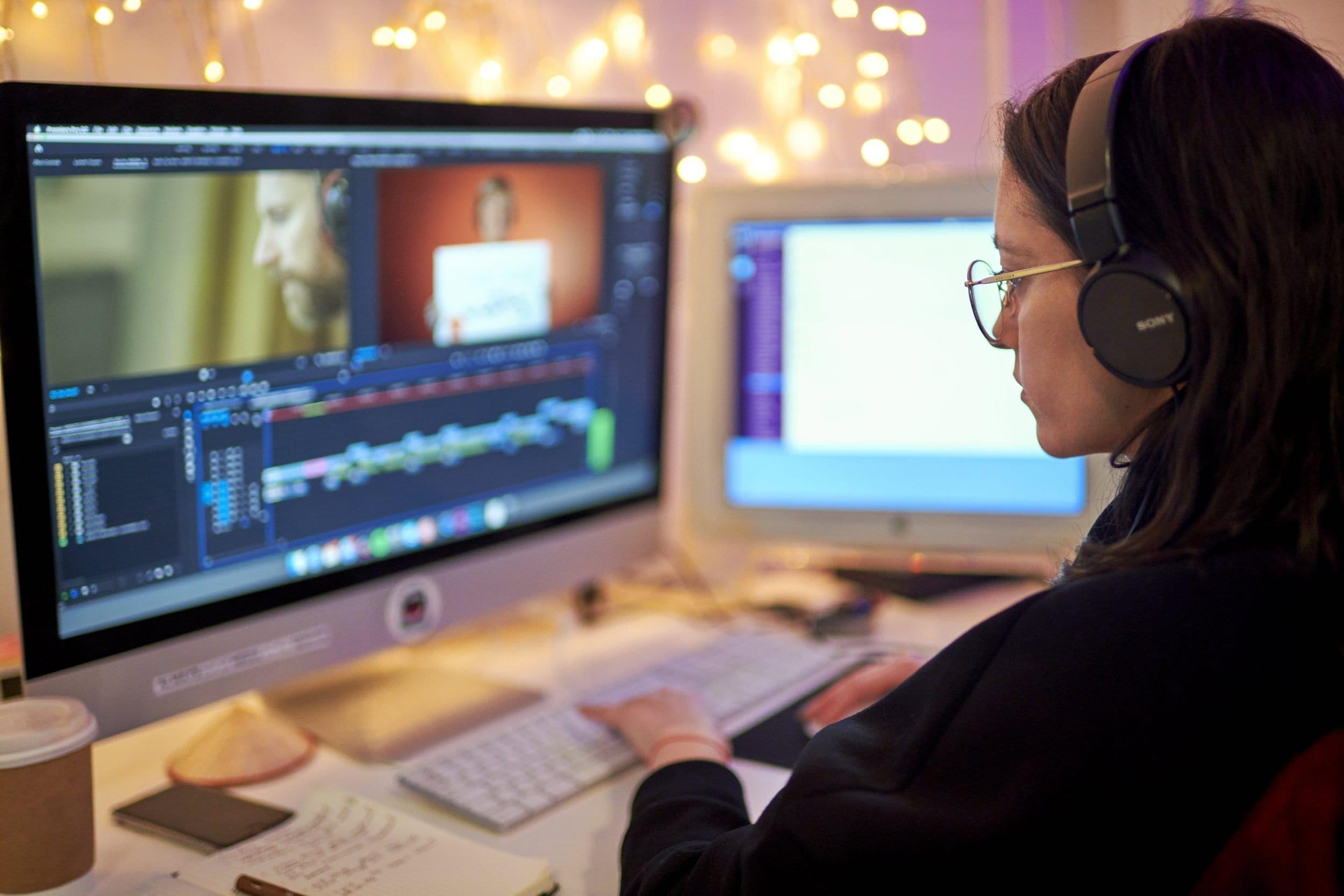 Bruna editing at a computer